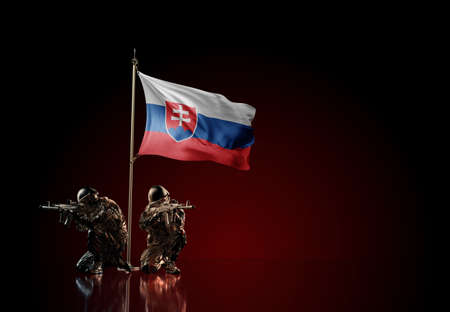 Concept of military conflict with soldier statues and waving national flag of Slovakia. Illustration of coup idea. Two guards defending the symbol of country against red wall