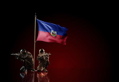 Concept of military conflict with soldier statues and waving national flag of Haiti. Illustration of coup idea. Two guards defending the symbol of country against red wall