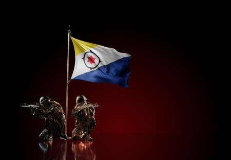 Concept of military conflict with soldier statues and waving national flag of Caribbean Netherlands. Illustration of coup idea. Two guards defending the symbol of country against red wall