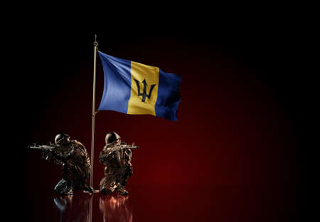 Concept of military conflict with soldier statues and waving national flag of Barbados. Illustration of coup idea. Two guards defending the symbol of country against red wall Reklamní fotografie