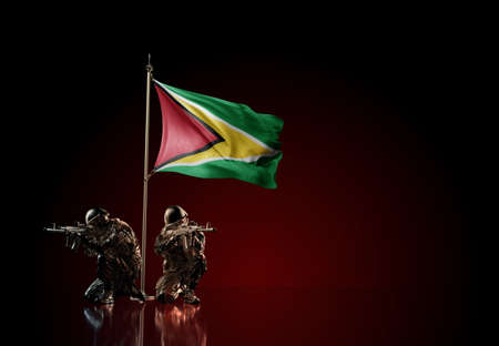 Concept of military conflict with soldier statues and waving national flag of Guyana. Illustration of coup idea. Two guards defending the symbol of country against red wall