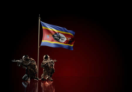 Concept of military conflict with soldier statues and waving national flag of Eswatini (Swaziland). Illustration of coup idea. Two guards defending the symbol of country against red wall