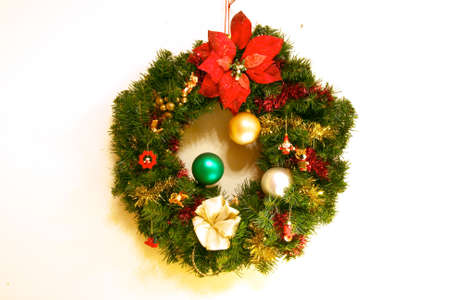 Christmas holiday decoration hung on a wall that can be used as a blurred background for christmas advertising.