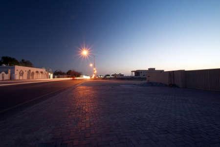 Umm Al Quwain coast road in the night close to the gulf sea. Stock Photo