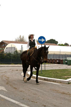 Woman riding gently on her horse on a public road at Roma Cavalli horse fair in Rome, Italy on April 2011.