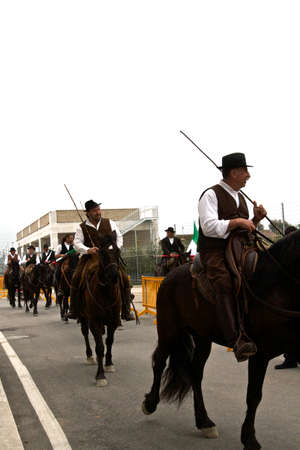 Pastors riding their horse at Roma Cavalli horse fair in Rome, Italy on April 2011. Editorial