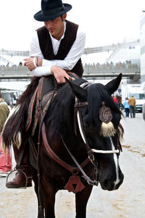 Italian country man on his horse at Roma Cavalli horse fair in Rome, Italy on April 2011.