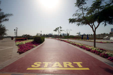 Start mark on a public running track in a public park Stock Photo