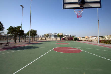 Basket outdoor field in a public park taken on the left side of the basket panel.