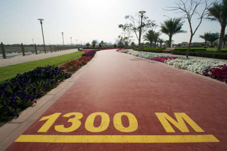 1300 m mark on a public running track in a public park