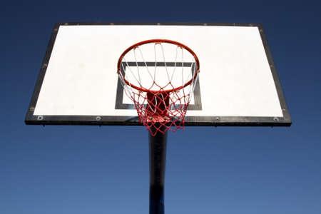 Backboard and its basket of a basketball field. Stock Photo