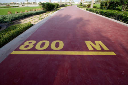 800 m mark on a public running track in a public park Stock Photo