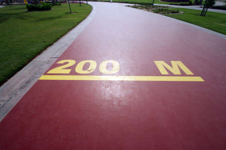 200 m mark on a public running track in a public park Stock Photo