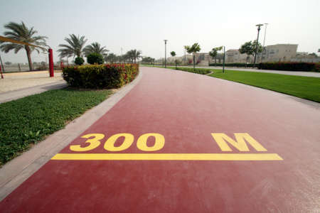 300 m mark on a public running track in a public park Stock Photo