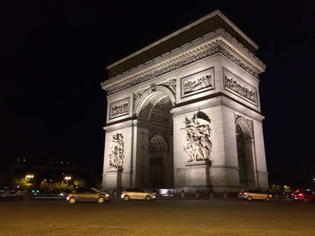 Triumph Arch in Paris Champs Elysees at night. One of the most visited monuments in France.