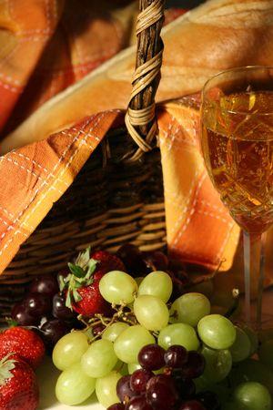 Picnic Basket with wine & fruit photo