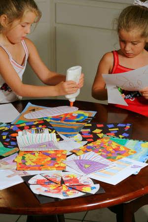 Two little girls doing art project