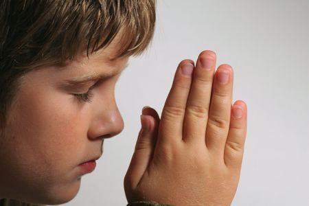 young boy praying 写真素材