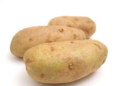 spud: Three potatoes on white