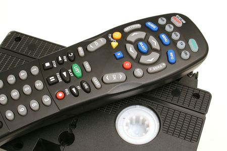remote control with vhs tapes upclose photo