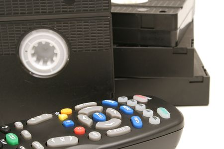 remote control vhs tapes background photo