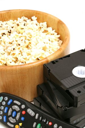 popcorn & video wremote control on white photo