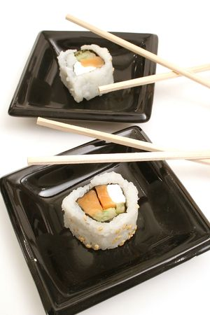 smoked salmon sushi vertical on top photo