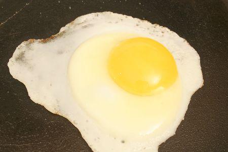 sizzle: single fried egg Stock Photo