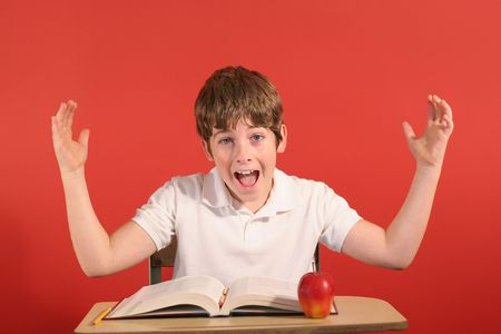 young boy at desk with hands up Stock Photo - 802163