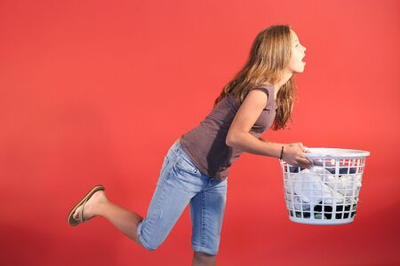 tripping: girl tripping with laundry