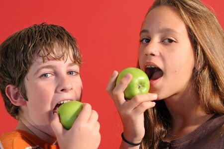 preteen  pure: boy & girl eating an apple
