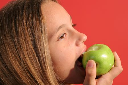 preteen  pure: girl eating an apple upclose Stock Photo