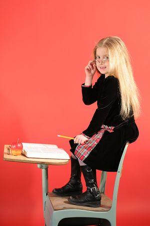 little girl sitting in school desk vertical Stock Photo - 828264