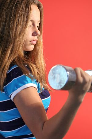 girl lifting dumbell weights vertical