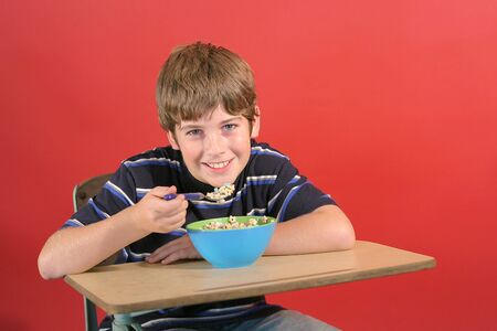 kid eating cereal at desk Stock Photo - 831641