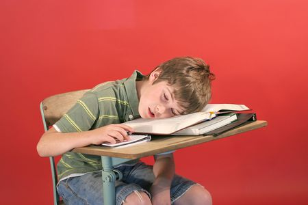 pre school: kid asleep at his desk