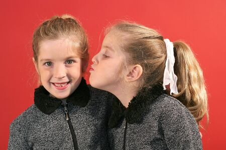 sister giving a kiss photo