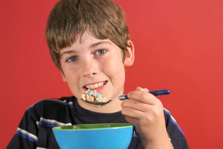 boy eating cereal photo