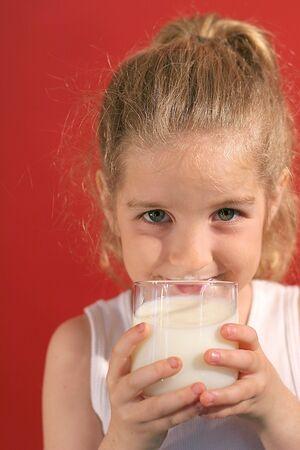 happy little girl drinking milk
