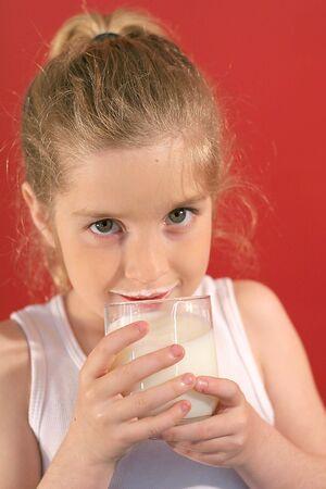 girl drinking milk with milk mustache Stok Fotoğraf