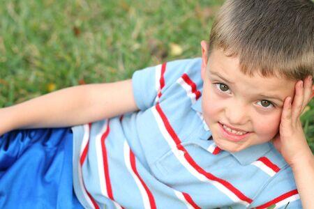 little boy in the grass photo