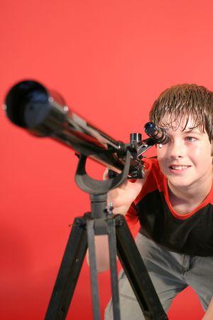 thru: boy looking thru telescope Stock Photo