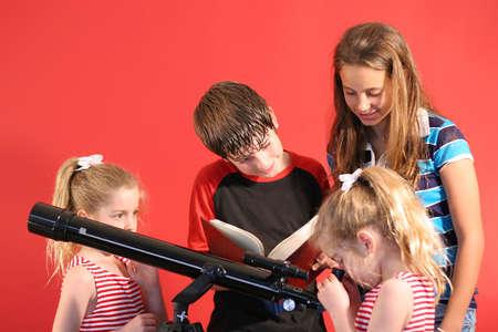 thru: children looking thru telescope Stock Photo