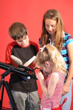 pre adolescent boys: children looking thru telescope vertical