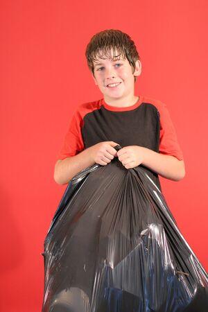 boy with trashbag