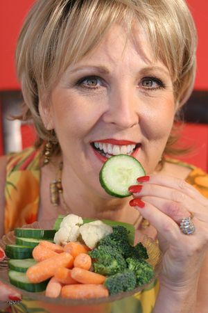 upclose: woman eating healthy food upclose vertical
