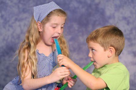 children sharing popsicles