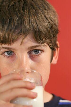 boy drinking milk vertical upclose Stok Fotoğraf