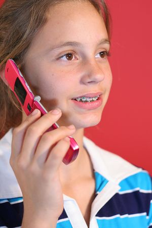 girl on cell phone vertical red photo