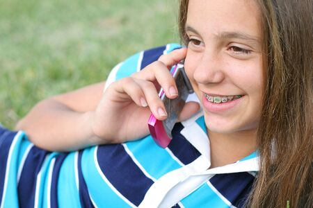 beautiful preteen girl: girl outside on cell phone